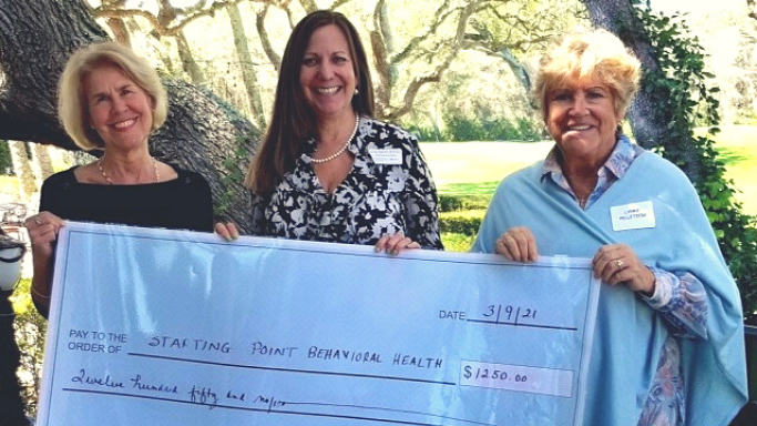 Laureen Pagel, CEO at Starting Point Behavioral Healthcare, accepting award from the Plantation Ladies Association of Amelia Island Community Outreach Chair, Peg Kolasa, and President, Lynne Pelletiere