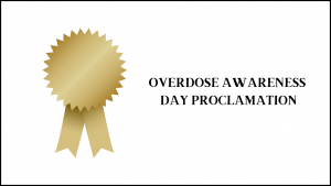 gold ribbon with text reading: overdose awareness day proclamation