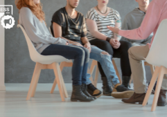men and women sitting in a circle receiving group therapy